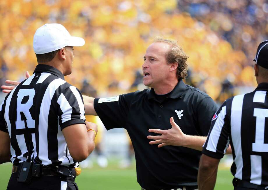 Mountaineers coach Dana Holgorsen, an occasional skydiver, says life is too short not to have a good time. Photo: Christopher Jackson, Associated Press / FRE170573 AP