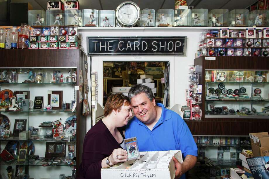 Ula and Todd Nelkin hold a rare football sports card they are selling to help fund an in vitro fertilization treatment. They've been trying to have a baby for some time. Photo: Michael Paulsen / © 2012 Houston Chronicle