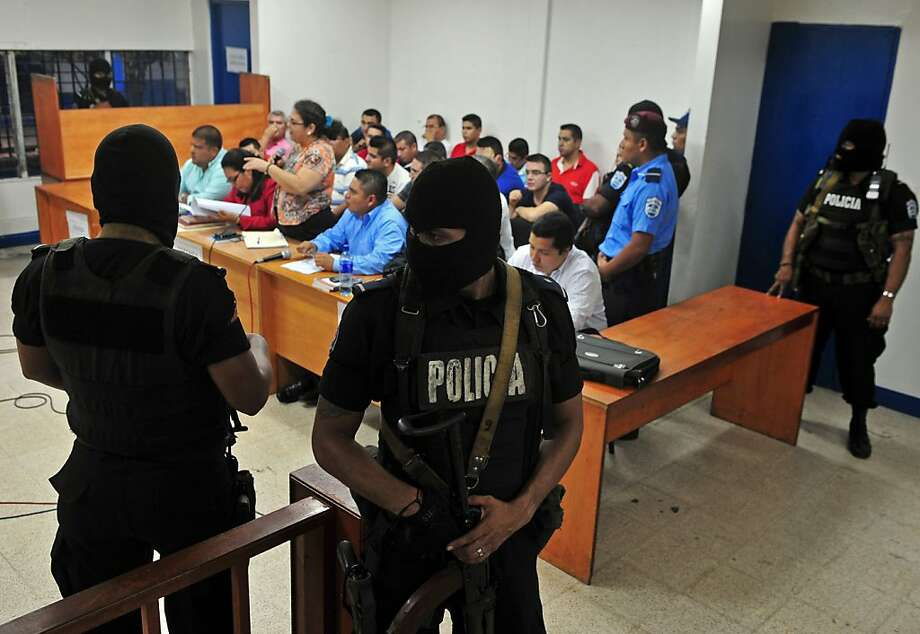 Police guard a Sept. 18 hearing in Managua, Nicaragua, where 18 people with fake credentials were charged with money laundering and drug trafficking. Photo: Hector Retamal, AFP/Getty Images