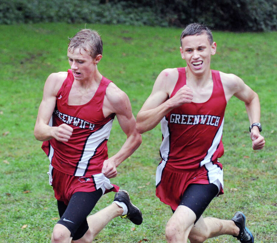 Greenwich High School cross country runners and cousins, Mark Jarombek, left, and Andrew Jarombek, right, fight it out near the finish line during the boys high school cross country meet at Greenwich Point, Tuesday afternoon, Oct. 2, 2012. Andrew was able to beat his cousin by a stride. Photo: Bob Luckey / Greenwich Time