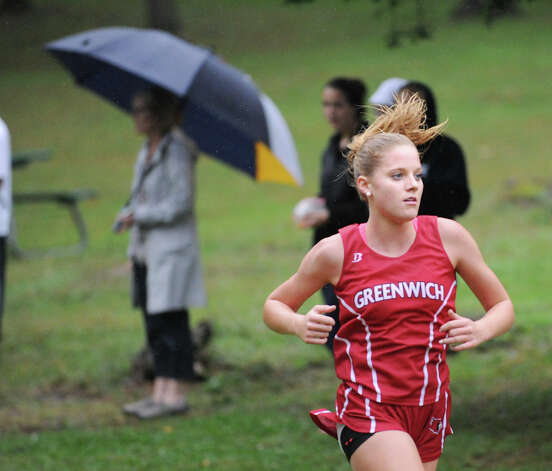 Jenny Goggin of Greenwich High School competes in the girls high school cross country meet at Greenwich Point, Tuesday afternoon, Oct. 2, 2012. Photo: Bob Luckey / Greenwich Time