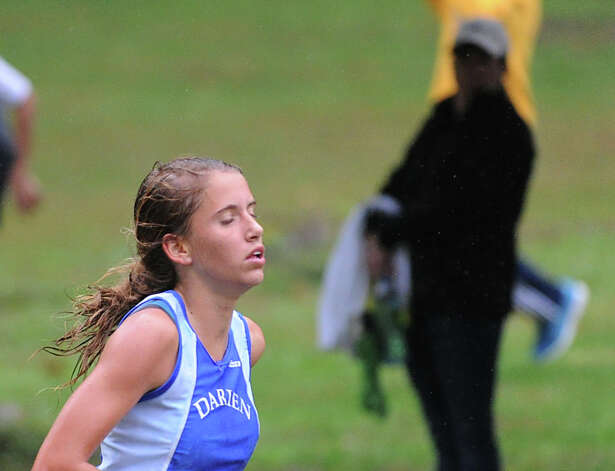 Anne Johnston of Darien High School, the winner of the girls high school cross country meet, near the finish line of the race held at Greenwich Point, Tuesday afternoon, Oct. 2, 2012. Photo: Bob Luckey / Greenwich Time