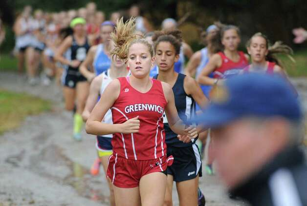 Jenny Goggin of Greenwich High School competes in the girls high school cross country meet, near the finish line of the race held at Greenwich Point, Tuesday afternoon, Oct. 2, 2012. Photo: Bob Luckey / Greenwich Time
