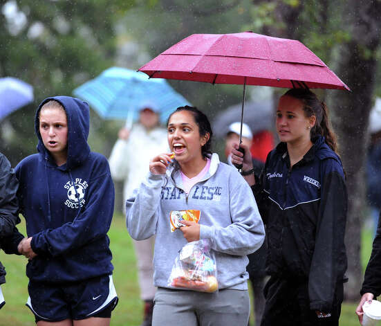 Fans cheer during the girls high school cross country meet at Greenwich Point, Tuesday afternoon, Oct. 2, 2012. Photo: Bob Luckey / Greenwich Time