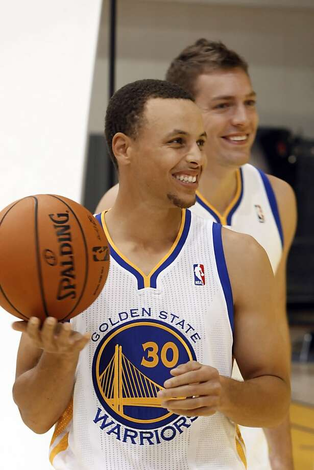 Stephen Curry, front, and David Lee, rear, joke around during a portrait session as the Golden State Warriors met with the press during their annual Media Day on Monday, October 1, 2012, at the team's Practice Facility in Oakland, Calif. Players discussed the upcoming 2012-13 NBA season. Photo: Carlos Avila Gonzalez, The Chronicle