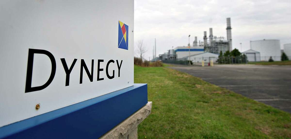 Dynegy Inc. signage is displayed outside of the company's natural gas fired 1200-megawatt Kendall Energy power plant in Minooka, Illinois, U.S., on Sunday, Nov. 6, 2011. Dynegy Inc. and its bondholders are headed to a possible showdown in bankruptcy court after the third-largest independent U.S. power producer withdrew an offer to swap as much as $1.25 billion of notes for cash and new debt valued at 28 to 60 percent of face value. Photographer: Daniel Acker/Bloomberg