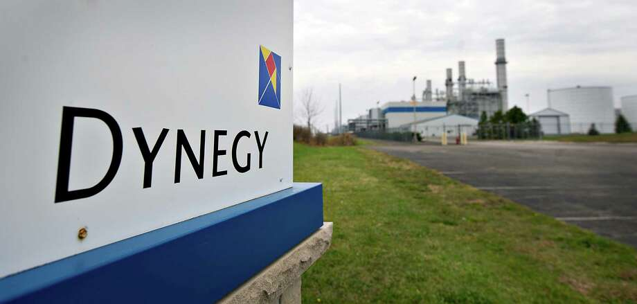 Dynegy Inc. signage is displayed outside of the company's natural gas fired 1200-megawatt Kendall Energy power plant in Minooka, Illinois, U.S., on Sunday, Nov. 6, 2011. Dynegy Inc. and its bondholders are headed to a possible showdown in bankruptcy court after the third-largest independent U.S. power producer withdrew an offer to swap as much as $1.25 billion of notes for cash and new debt valued at 28 to 60 percent of face value. Photographer: Daniel Acker/Bloomberg Photo: Daniel Acker