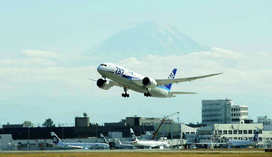 With Mount Rainier in the background, the first scheduled Boeing 787 airplane to depart from Seattle-Tacoma International Airport takes off  Tuesday, Oct. 2, 2012 in Seattle. The plane, operated by All Nippon Airways, will serve ANA's Seattle-Tokyo route. Photo: AP