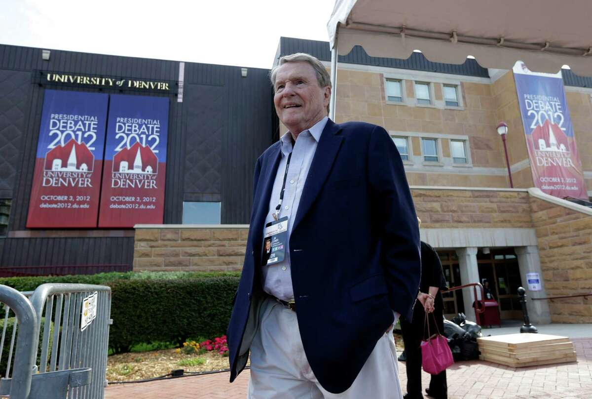 Jim Lehrer walks outside the Magness Arena at the Daniel L. Ritchie Center for Sports and Wellness, site of Wednesday's presidential debate, on the campus of the University of Denver, Monday, Oct. 1, 2012, in Denver. Lehrer is the debate moderator. (AP Photo/Charlie Neibergall)
