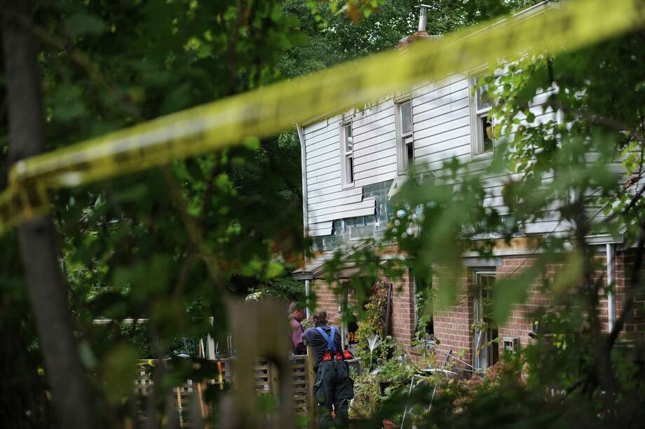 A 42-year-old man was killed and a woman was seriously injured Tuesday morning, Oct. 2, 2012, in a fire that broke out in their home on Havemeyer Lane near MacArthur Drive in Old Greenwich, police said. Photo: Helen Neafsey / Greenwich Time