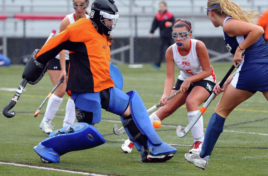 New Canaan goalie Carrie Owen blocks a Staples goal attempt, during girls field hockey action in New Canaan, Conn. on Tuesday October 2, 2012. Photo: Christian Abraham / Connecticut Post
