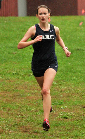 Immaculate's Carly Schuyler nears the finish line in first place during the cross country meet at Tarrywile Park in Danbury on Tuesday, Oct. 2, 2012. Photo: Jason Rearick / The News-Times