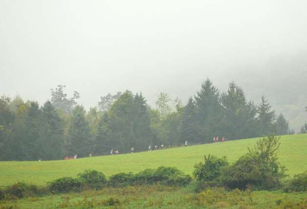 The girls teams run on the far side of the meadow during the cross country meet at Tarrywile Park in Danbury on Tuesday, Oct. 2, 2012. Photo: Jason Rearick / The News-Times