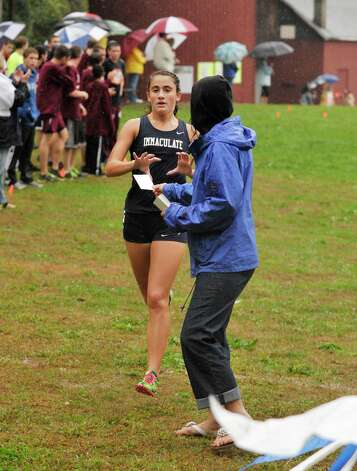 Immaculate's Jess Wojnicki crosses the finish line in second place during the cross country meet at Tarrywile Park in Danbury on Tuesday, Oct. 2, 2012. Photo: Jason Rearick / The News-Times