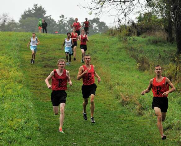 The boys run down a hill during the cross country meet at Tarrywile Park in Danbury on Tuesday, Oct. 2, 2012. Photo: Jason Rearick / The News-Times
