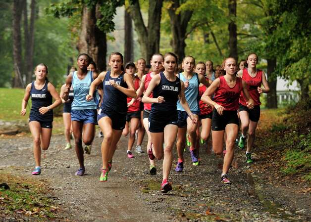The girls begin their run during the cross country meet at Tarrywile Park in Danbury on Tuesday, Oct. 2, 2012. Photo: Jason Rearick / The News-Times