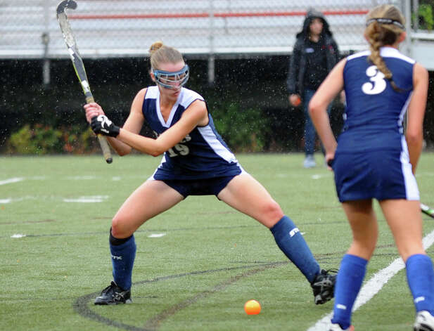 Staples #19 Elizabeth Bennewitz attempts a goal shot, during girls field hockey action against New Canaan in New Canaan, Conn. on Tuesday October 2, 2012. Photo: Christian Abraham / Connecticut Post