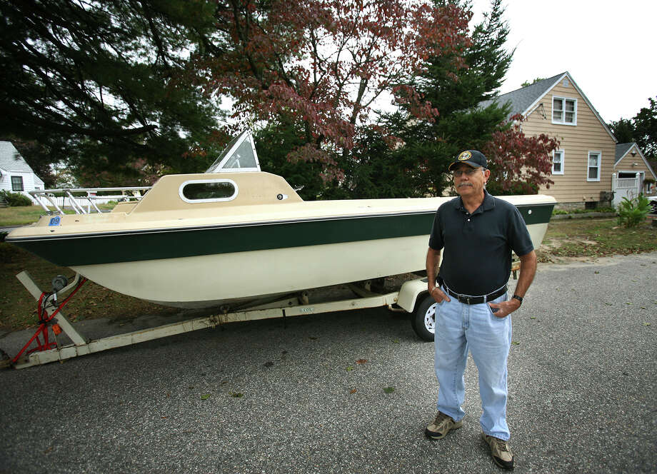Tony Mendez said he has received no response from police about an abandoned boat next to his home at 585 Old Town Road in Bridgeport. The boat was left on Thursday night. Photo: Brian A. Pounds / Connecticut Post