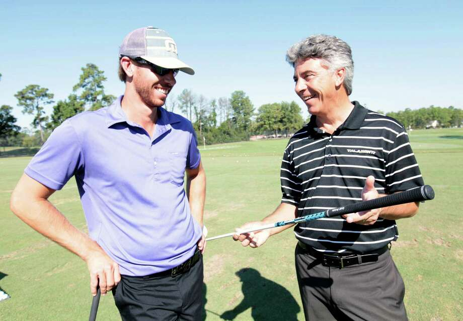Talamonti Shafts founder & C.E.O. Philip Talamonti (right) shows professional golfer Bryant Lach new advancements in his latest release of shafts at the practice tee of the Tournament Course at The Woodlands Country Club. Photo: Eric Christian Smith