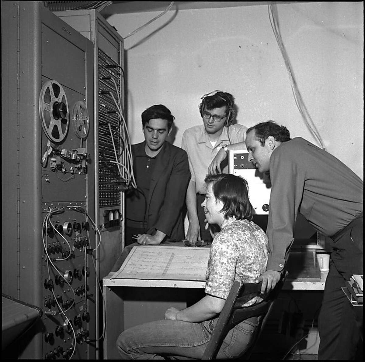 TAPEMUSIC-29MAR1964-AF - Ramon Sender, Mike Callahan, Morton Subotnick, Pauline Oliveros, at the San Francisco Tape Music Center, with all sorts of sound generators. Tape Center wants $1200 to transform itself from a local into and international institution. Photo by Art Frisch