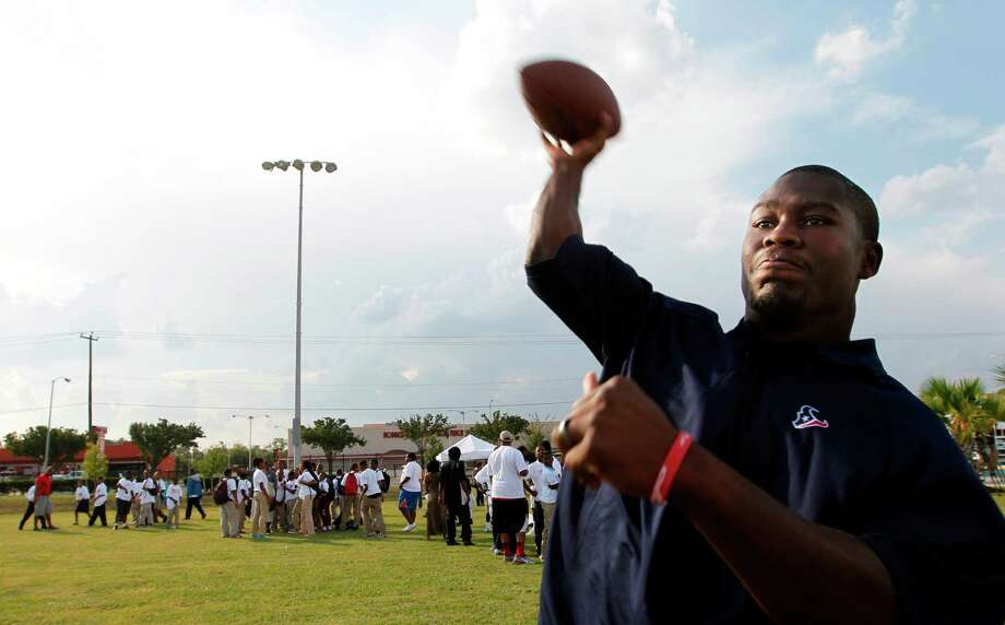 Texans RB Justin Forsett throws football to flag football players before he joins them on the field at the Houston Texans YMCA on Tuesday, Oct. 2, 2012, in Houston. Photo: Mayra Beltran, Houston Chronicle / © 2012 Houston Chronicle