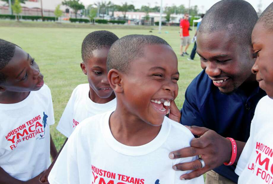 Houston Texans RB Justin Forsett signs autographs for flag football  players before practice at the Houston Texans YMCA on Tuesday, Oct. 2, 2012, in Houston. The Texans donated $200,000 to the Texans YMCA to fund the flag football program before the team's preseason opener. Photo: Mayra Beltran, Houston Chronicle / © 2012 Houston Chronicle