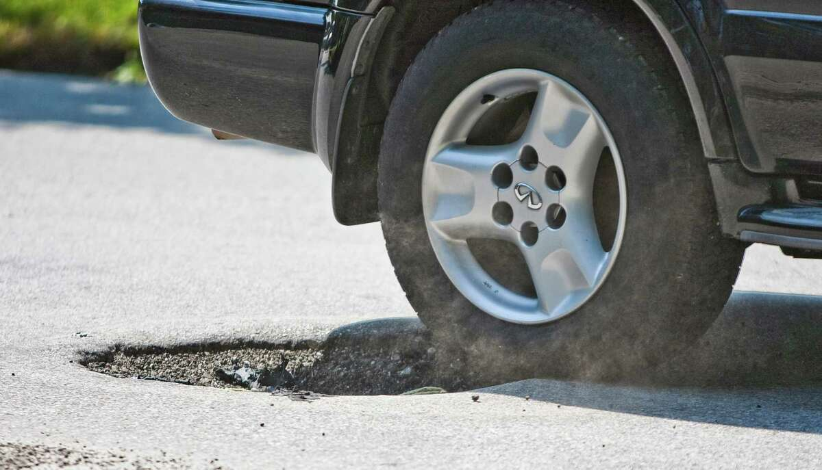 Potholes like this one on Watson in Woodland Heights add to vehicle maintenance costs.