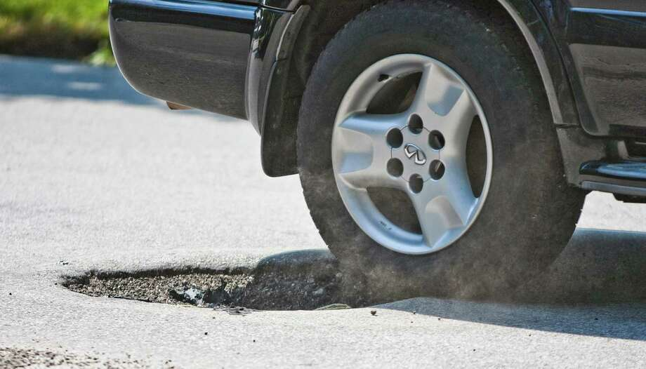 Click the slideshow to see which Houston streets had the most pothole reports in the past 12 months, according to city 311 data. Photo: Nick De La Torre / © 2012  Houston Chronicle