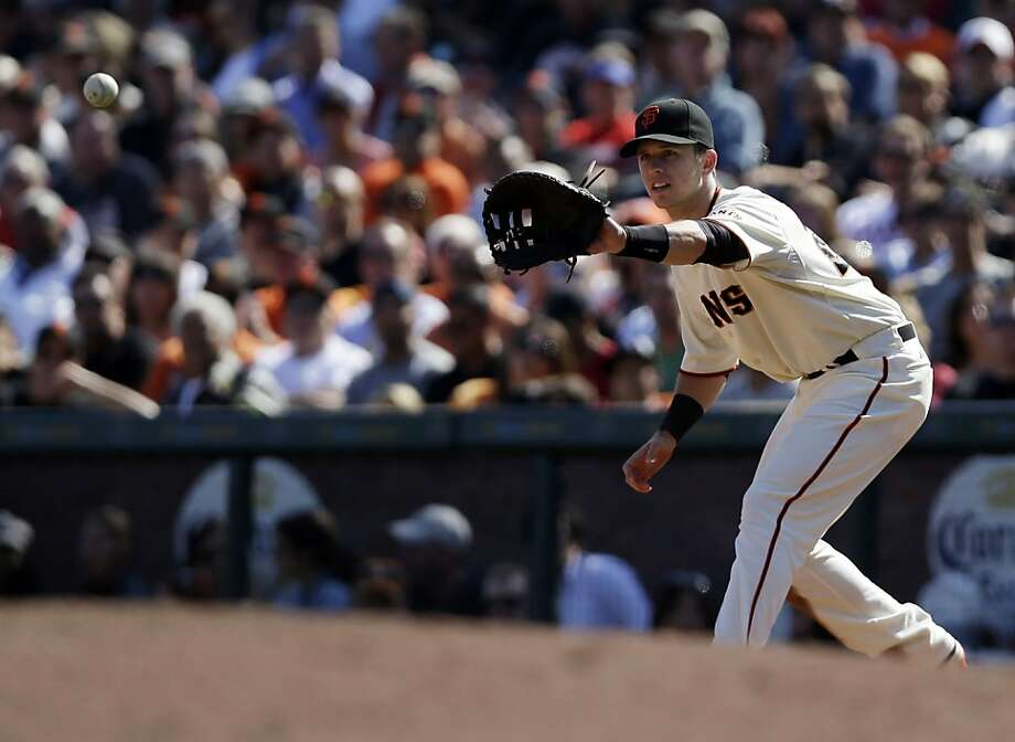 Buster Posey, who plays a lot of first base already, has the athleticism to play third base, manager Bruce Bochy said. Photo: Marcio Jose Sanchez, Associated Press