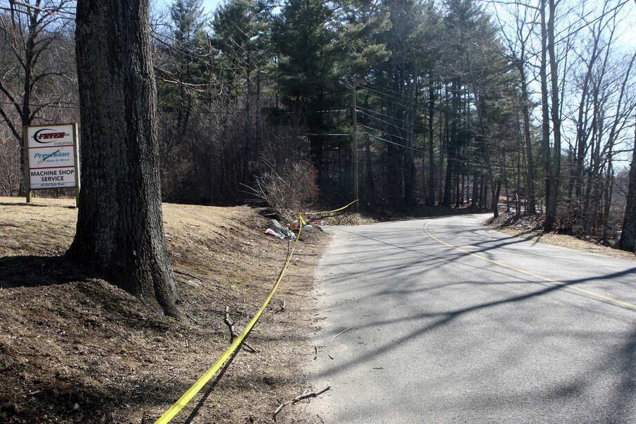 A memorial and police tape remain at the scene of a car crash on Old State Rd. in Oxford, Conn. on Sunday, March 11, 2012. Oxford High School sophomore and football player Brandon Giordano died at the scene on Friday night. Photo: B.K. Angeletti / Connecticut Post