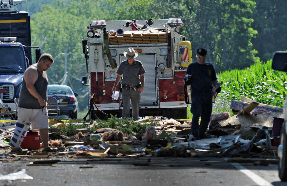 Investigators and firefighters comb the explosion site Thursday morning July 14, 2011 on Route 29 in Salem, N.Y. for clues.  (Skip Dickstein / Times Union archive) Photo: SKIP DICKSTEIN / 2011