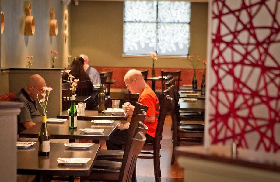 Yiping picks up where a succession of Chinese and Vietnamese restaurants left off, but with a completely redone main dining room, back room and wine bar. Photo: John Storey