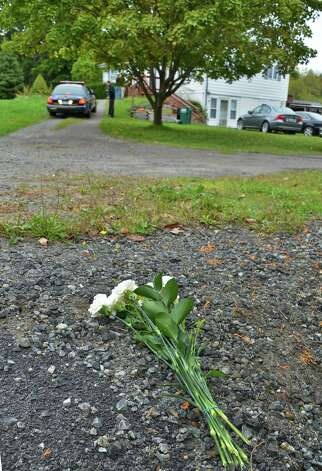 Flowers placed at the bottom of the driveway Tuesday Oct. 2, 2012, where 11-year-old Lane Rowe died after he tried to stop a minivan that was rolling backward with three other children inside on Blue Barns Road in the town of Ballston yesterday.  (John Carl D'Annibale / Times Union) Photo: John Carl D'Annibale / 00019500A