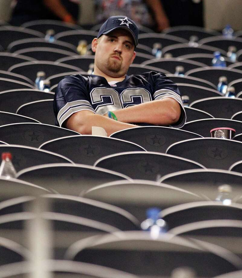 Don't get a Cowboys fan Texans gear, or vice versa.  Photo: LM Otero, Associated Press / AP