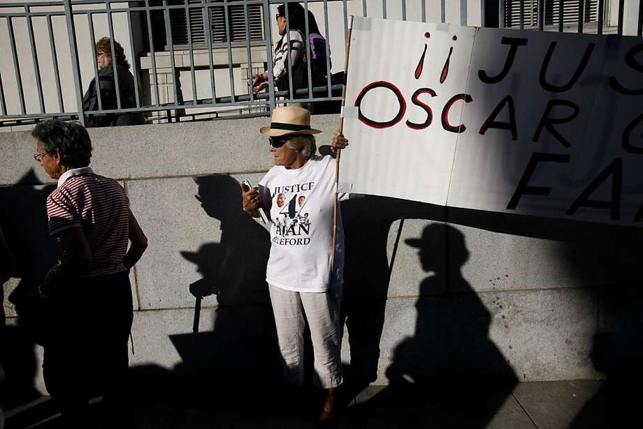 Kathy Colliau of Walnut Creek carries a sign during a march to Oakland City Hall to protest at the City Council meeting, where, under new rules, more than 100 people were locked out. Photo: Sarah Rice, Special To The Chronicle