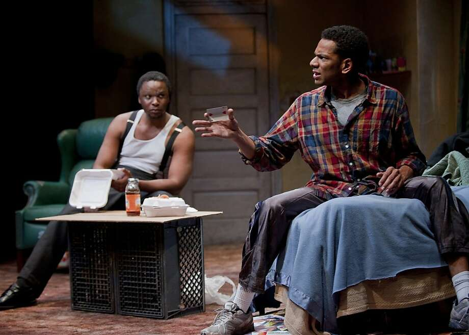 "Lincoln (Bowman Wright, left) criticizes the three-card monte skills of brother Booth (Biko Eisen-Martin) in ""Topdog/Underdog."" Photo: David Allen"