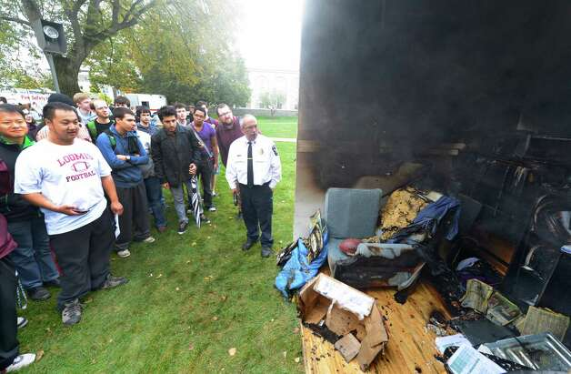 Students look over the damage to a mock dorm room after it was set on fire as part of Union College's annual safety day in Schenectady, N.Y. Oct. 2, 2012.   Schenectady Fire Department, law enforcement and other agencies joined Campus Safety, Health Services, Emergency Medical Services and other campus groups in providing information on fire and personal safety.    (Skip Dickstein/Times Union) Photo: Skip Dickstein