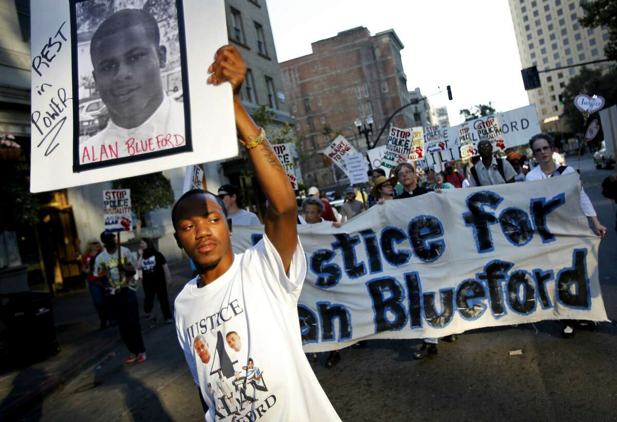 Jimmy Blueford, cousin of the slain Alan Blueford, marches through downtown Oakland to City Hall to protest at the city council meeting in Oakland, Calif., Tuesday, October 2, 2012. The family of Alan Blueford, who was killed in May by a police officer, are demanding the police finish their investigation of Blueford's shooting.