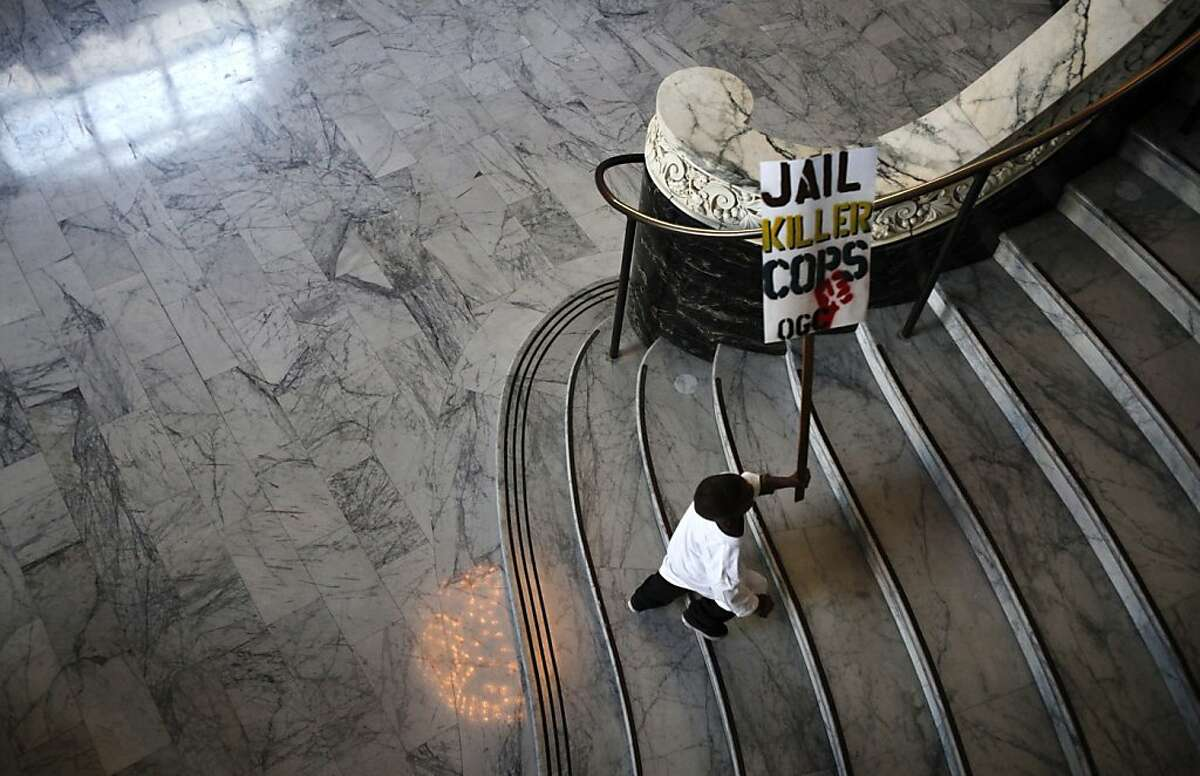 A young boy runs up the stairs at City Hall to join protestors outside the doors of the city council meeting in Oakland, Calif., Tuesday, October 2, 2012. The family of Alan Blueford, who was killed in May by a police officer, are demanding the police finish their investigation of Blueford's shooting.