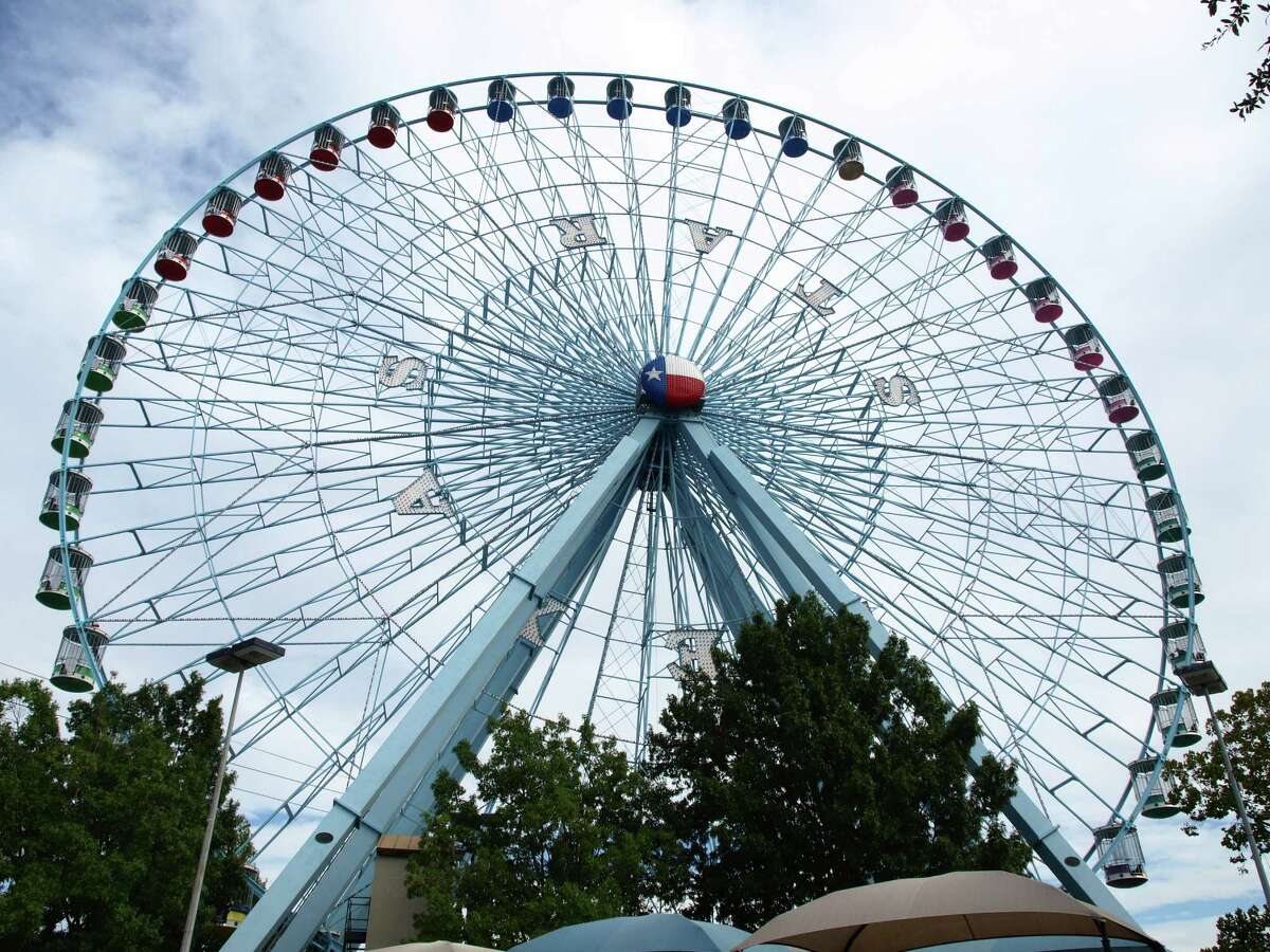 The Texas State Fair's 21-story Ferris wheel provides a bird's-eye view of the fairgrounds and downtown Dallas. A ride of the Ferris wheel costs 14 coupons ($7).