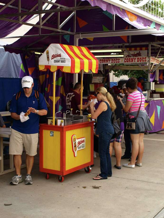 Fletcher s Corny Dogs have been a focal point of the fair for 70 years. They are among the less messy food options you can find. Photo: San Antonio Express-News