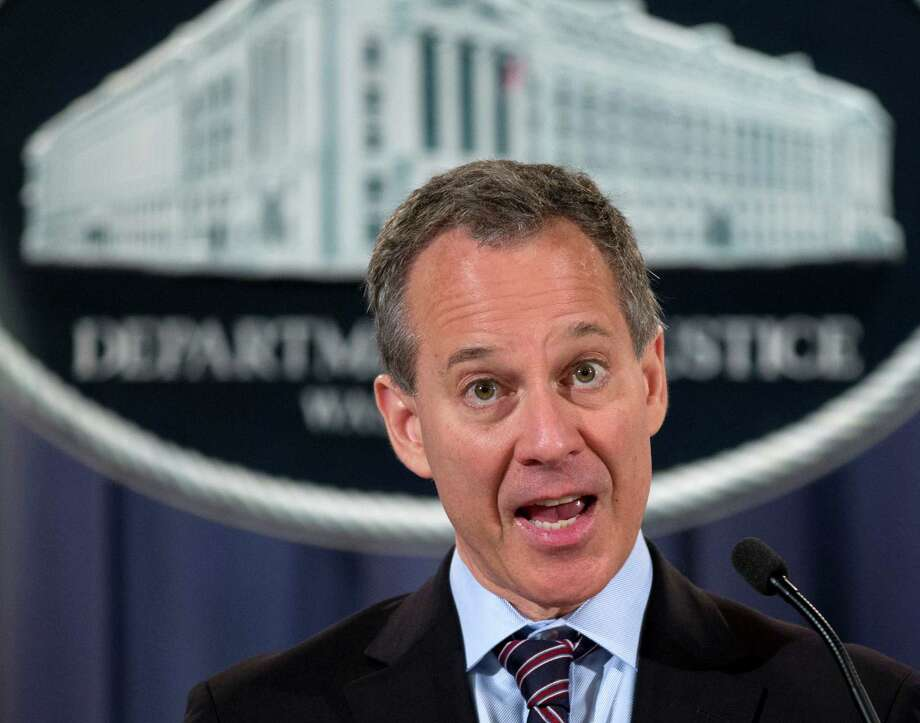 New York Attorney General Eric Schneiderman speaks during a news conference at the Justice Department in Washingotn, Tuesday, Oct. 2, 2012, in Washington. The federal government onTuesday threw its support behind a lawsuit against JPMorgan Chase accusing Bear Stearns, the investment bank JPMorgan bought in 2008, of engaging in massive fraud in deals involving billions in residential mortgage-backed securities.   (AP Photo/Carolyn Kaster) Photo: Carolyn Kaster