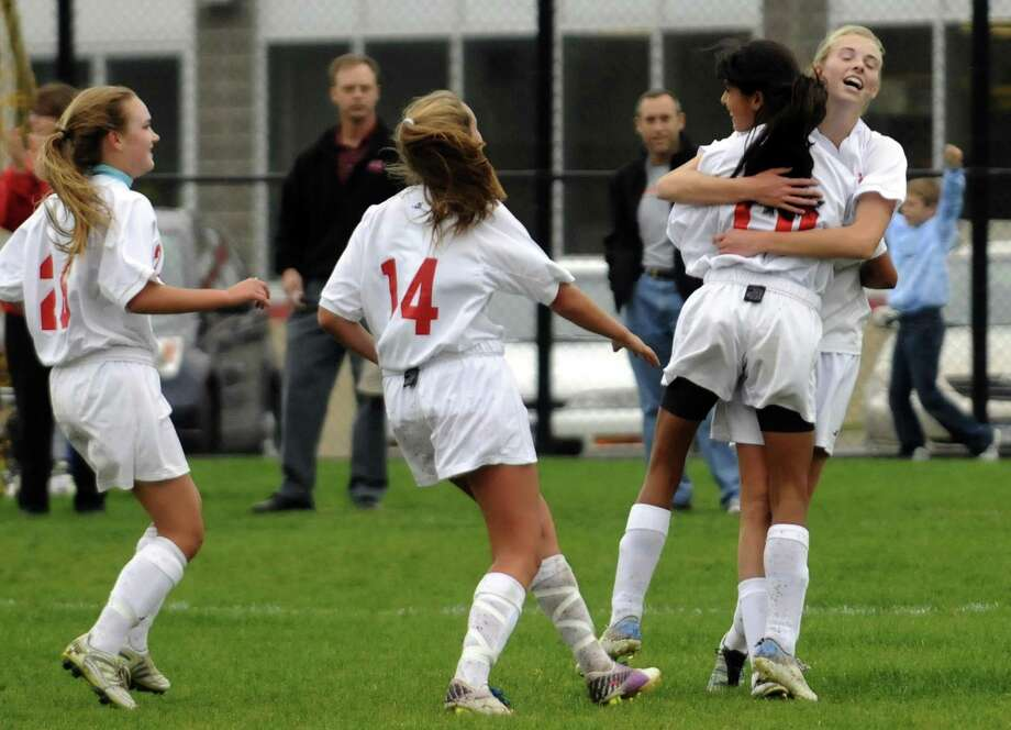 Niskayuna's Meghan Doyle and Anka Parzych, right, hug in celebration after scoring a goal during their girl's high school soccer match against Bethlehem in Niskayuna, NY Tuesday Oct. 2, 2012. (Michael P. Farrell/Times Union) Photo: Michael P. Farrell