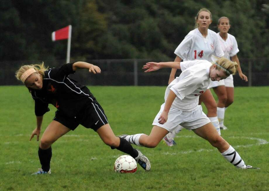 Niskayuna's Maddie Karafanda, right, and Bethlehem's Stephanie Dootz battle for the ball during their girl's high school soccer match in Niskayuna, NY Tuesday Oct. 2, 2012. (Michael P. Farrell/Times Union) Photo: Michael P. Farrell