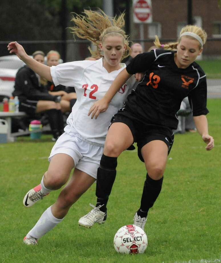 Niskayuna's Kelly Harlage, left, and Bethlehem's Abby Seymour battle for the ball during their girl's high school soccer match in Niskayuna, NY Tuesday Oct. 2, 2012. (Michael P. Farrell/Times Union) Photo: Michael P. Farrell