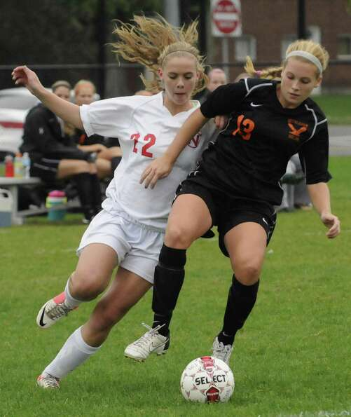 Niskayuna's Kelly Harlage, left, and Bethlehem's Abby Seymour battle for the ball during their girl'