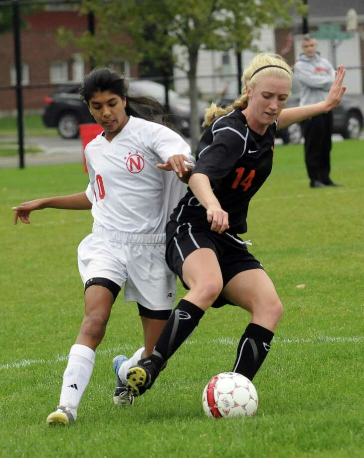 Niskayuna's Anka Parzych, left, and Bethlehem's Samantha Taillon battle for the ball during their girl's high school soccer match in Niskayuna, NY Tuesday Oct. 2, 2012. (Michael P. Farrell/Times Union) Photo: Michael P. Farrell