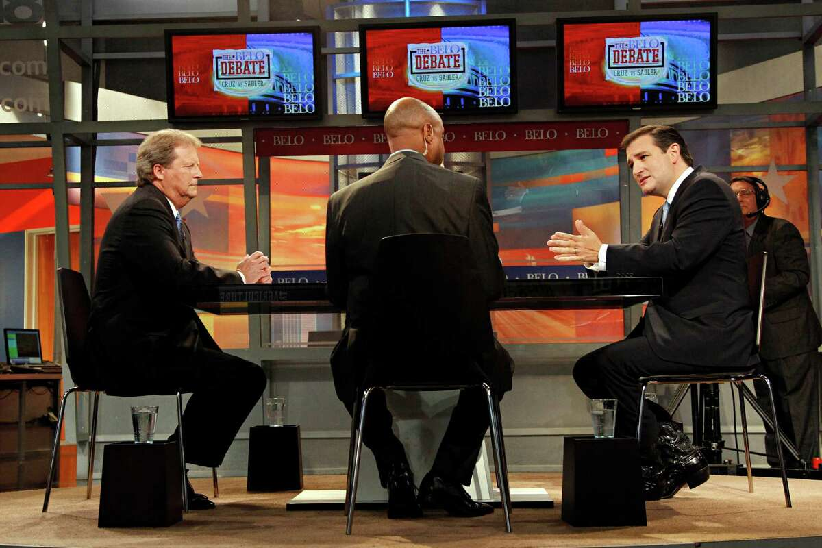 Ted Cruz, right, Republican candidate for the U.S. Senate, answers a question from the Dallas Morning News' Gromer Jeffers as Democratic opponent Paul Sadler, left, looks on during the debate Tuesday night.