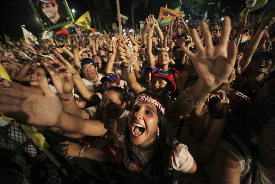 Supporters of opposition presidential candidate Henrique Capriles cheer during a campaign rally in Barcelona, Venezuela, Tuesday, Oct. 2, 2012. Capriles will run against President Hugo Chavez in the presidential elections  Oct. 7. (AP Photo/Fernando Llano) Photo: Fernando Llano, Associated Press