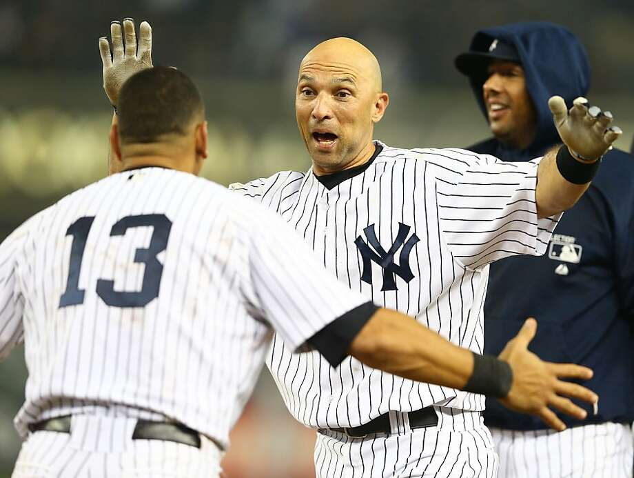 Raul Ibanez #27 of the New York Yankees celebrates with Alex Rodriguez #13 after hitting a walk-off single against the Boston Red Sox in the twelfth inning to win the game 4-3. Photo: Al Bello, Getty Images